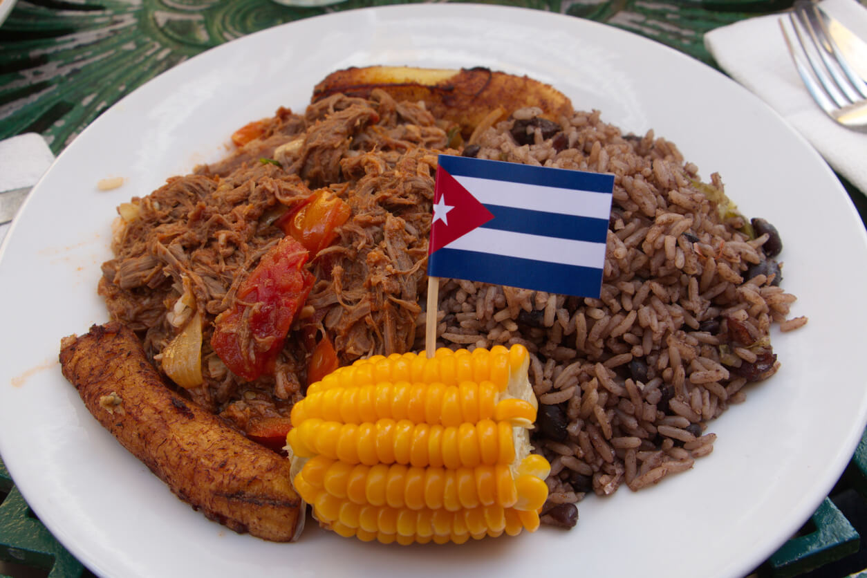 Cuban food with small cuban flag